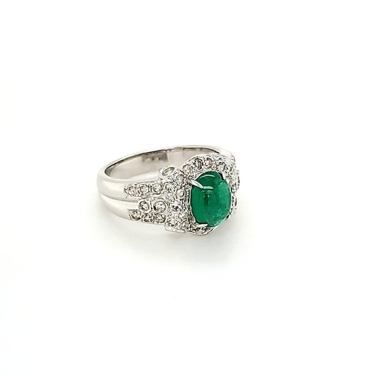 Emerald Cabochon And Diamond White Gold Engagement Ring:  A bright green Emerald Cabochon weighing 1.47 carat accented by a variety of White Diamonds of fine quality weighing 0.67 carat, this ring is a great option for an engagement ring! The