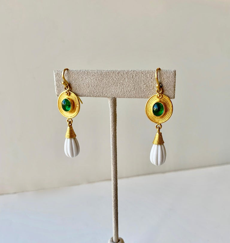 Oval Emerald cabochon earrings with carved Cachalong ( white Agathe) dangles in the style of Roman antiquity in 22 Karat gold and 20 Karat gold. Hand made in New York, one of a kind.