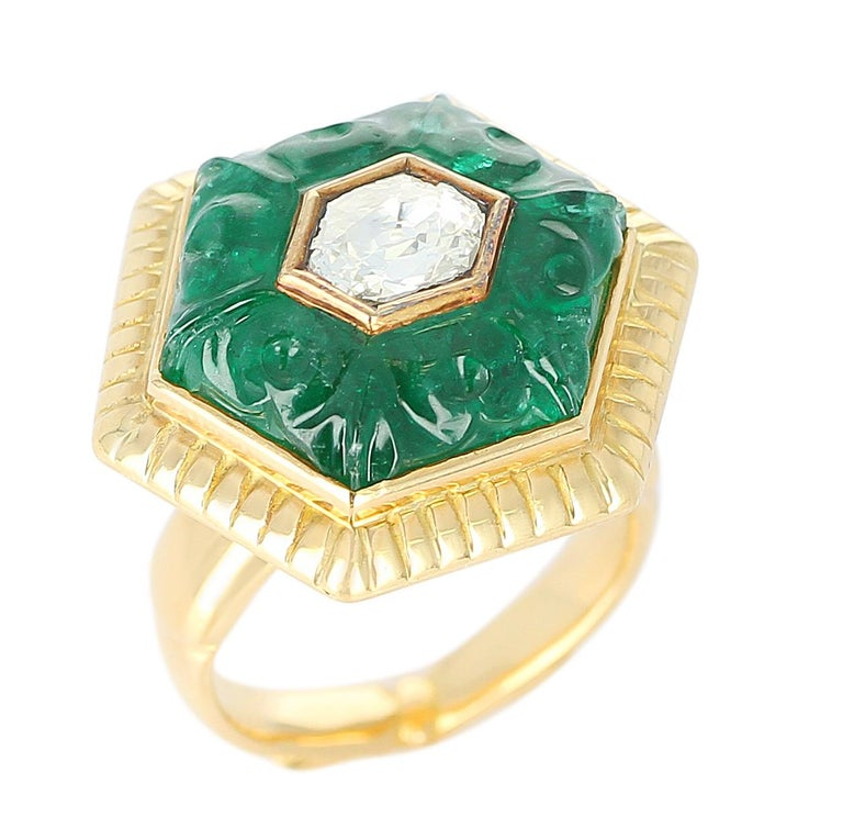 An Emerald Carving Ring with a Diamond Rose Cut in the middle, in 22 Karat Yellow Gold. Diamond Weight: 0.75 carats, Total Weight: 18.08 grams, Ring Size US 5.75.