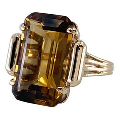 Emerald Cut 18 Carat Honey-Colored Quartz Solitaire in Yellow Gold, circa 1970