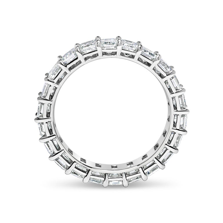 Diamond Eternity Band set in Platinum. 22 Emerald cut diamonds are D-E-F VVS2-VS2 . Carat weight = 3.80 ct. Total ring weight 4.5 grams. Ring size 5.5. Can be sized upon request. This ring is customizable, price may vary depending on modifications