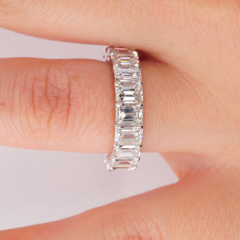 Diamond Eternity Band set in Platinum. 20 Emerald cut diamonds are D-E-F-G VVS2-VS1 . Carat weight = 6.22 ct. All stones are GIA-certified.  Total ring weight 6.50 grams. Ring size 6. Can be sized upon request. This ring is customizable, price may