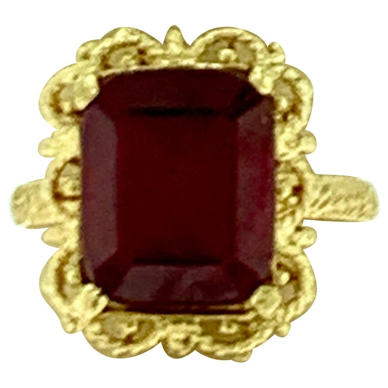 Emerald Cut 7 Carat Treated Ruby 18 Karat Yellow Gold Ring For Sale