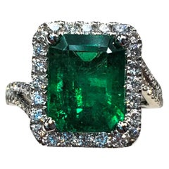 Emerald Cut and White Diamond Ring