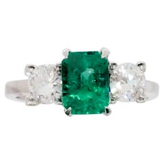 Emerald Cut and White Diamond Three-Stone Ring