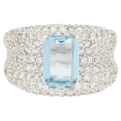 Emerald Cut Aquamarine and Diamond Bombe Ring in 18 Karat White Gold