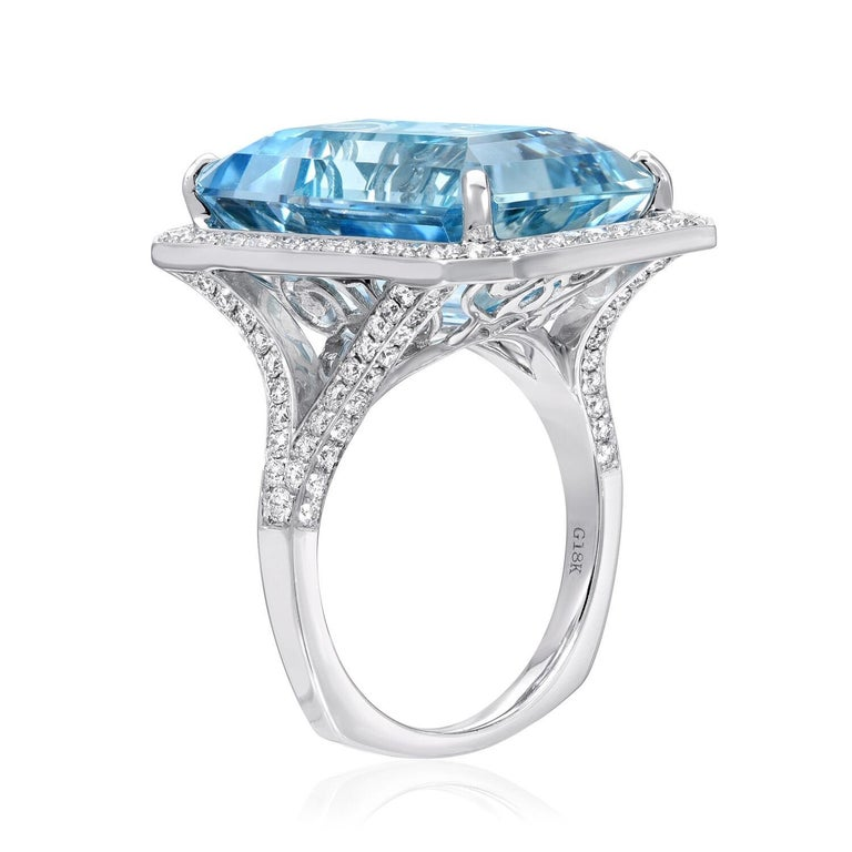 Emerald cut Aquamarine weighing a total of 15 carats, set in a 1.20 carat Diamond 18K white gold ring. Ring size 6.5. Resizing is complementary upon request.  Returns are accepted and paid by us within 7 days of delivery. Rings resized upon request,