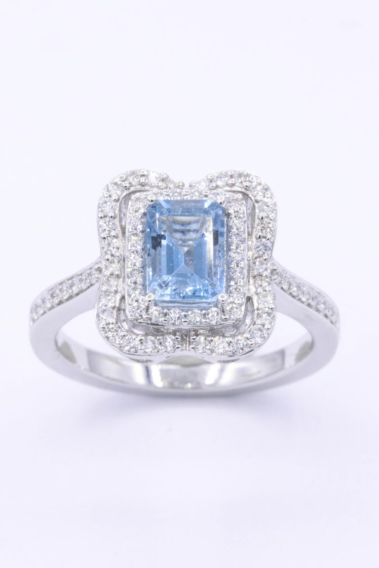 14K white gold the center stone is a beautiful emerald cut Aquamarine 0.92 cts and the diamonds weight 0.43 cts. Aquamarine measures 7 x 5 mm The top of the ring measures 1.2 cm x 1cm The ring will be sized to your finger size