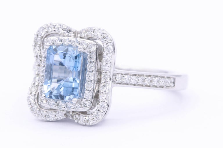 Contemporary Emerald Cut Aquamarine with Diamonds Halo Cocktail Ring For Sale
