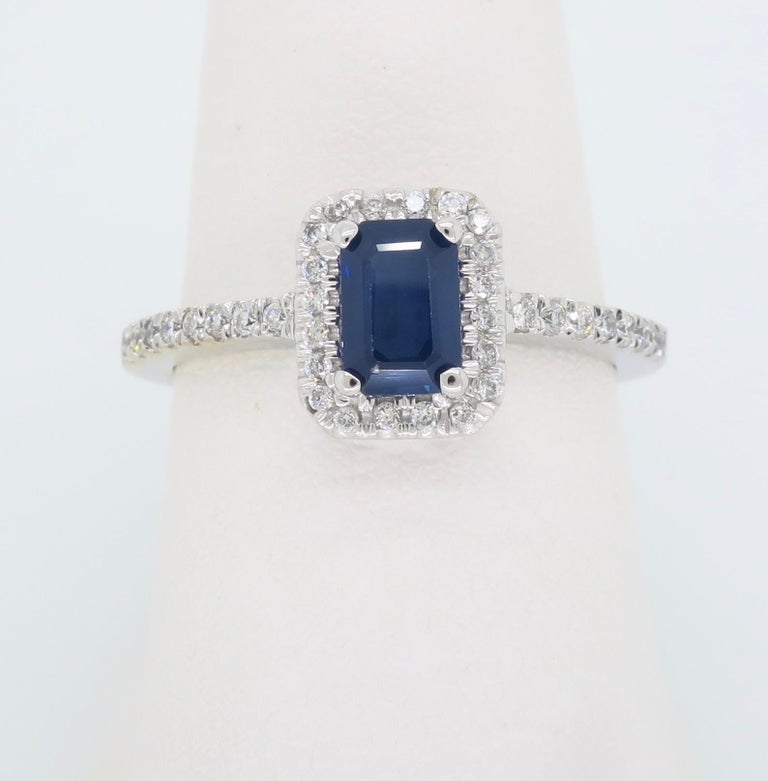 Halo style sapphire and diamond ring crafted in 14k white gold.   Gemstone: Sapphire & Diamonds Gemstone Carat Weight:  Approximately .63CT Diamond Carat Weight:  Approximately .20CTW Diamond Cut: Round Brilliant Cut Color: Average G-J Clarity: