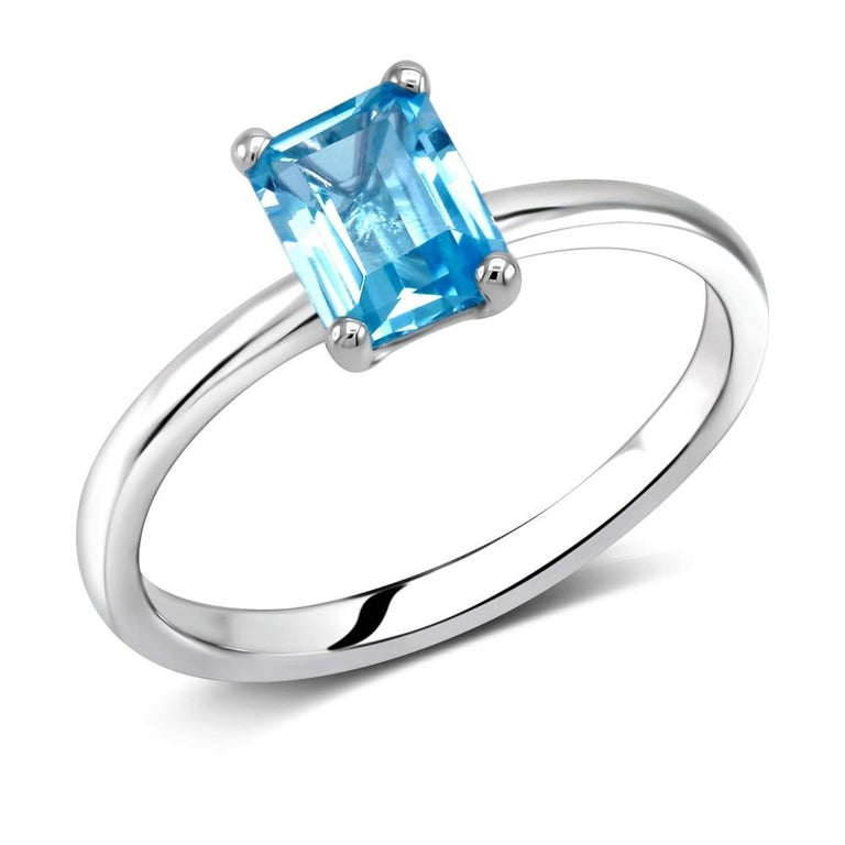 Sterling Silver solitaire emerald cut ring  Blue Topaz weighing one carat Blue topaz measuring 7x5 millimeter  Ring finger size 6.5 New Ring The ring can be resized White gold plated  Handmade in the USA