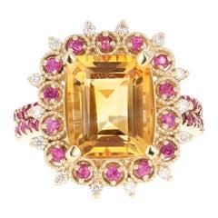 5.31 Carat Emerald Cut Citrine, Sapphire and Diamond 14 Karat Yellow Gold Ring