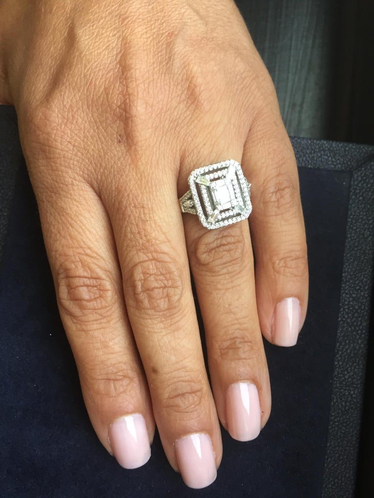 This cocktail ring is a true statement to any look. This ring has an emerald cut diamond in the middle and is surrounded by two rows of round diamonds. This ring is set in 18k White Gold, total Carat wt. is 1.20, color F, clarity VS.