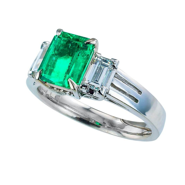 Emerald cut Colombian emerald baguette diamond platinum ring circa 1980.  Love it because it caught your eye, and we are here to connect you with beautiful and affordable jewelry.  It is time to claim a special reward for Yourself!  Simple and