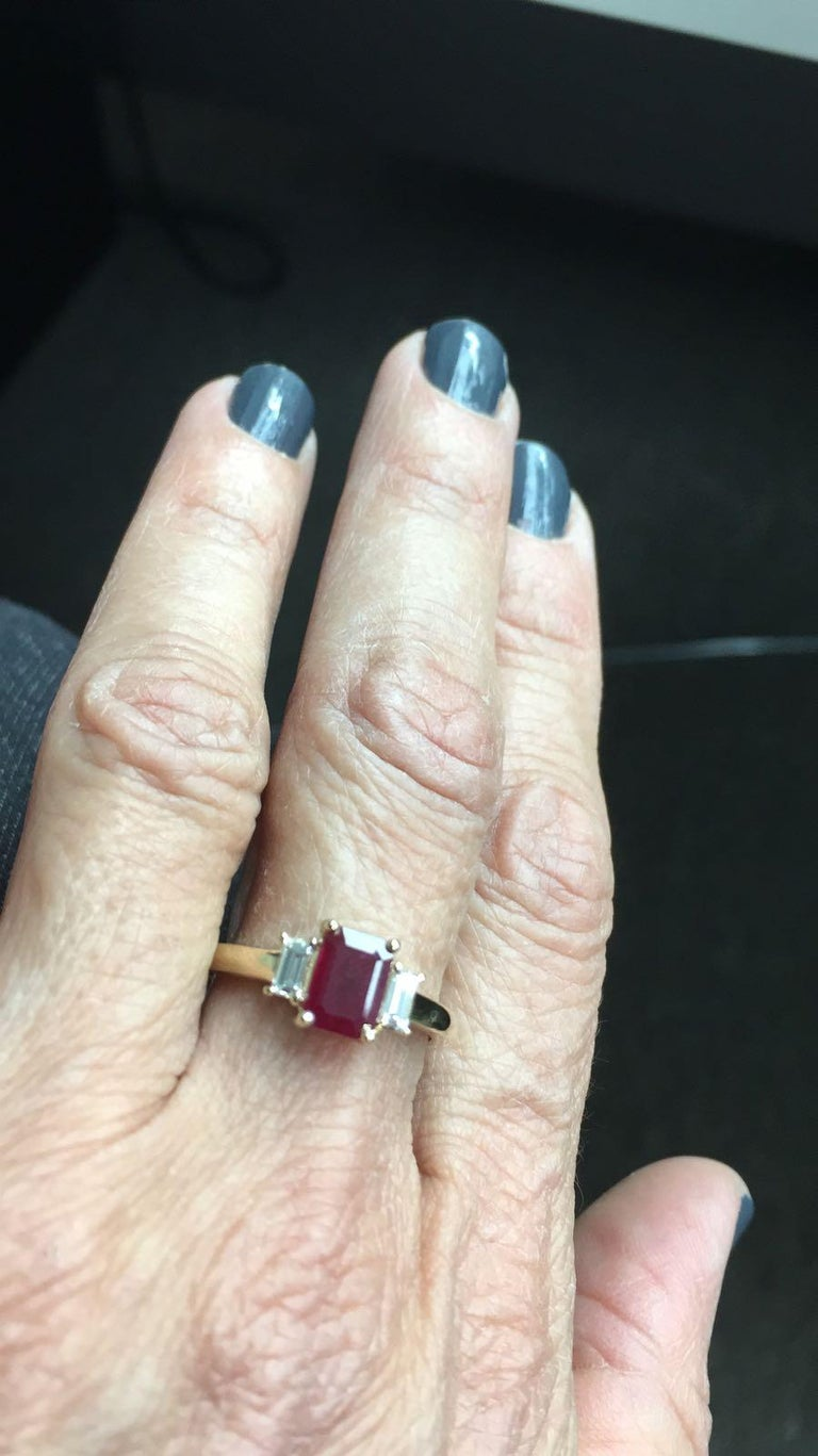The emerald cut / cushion ruby in this ring has a total carat weight of 0.98 carats. The diamonds have a total carat weight of 0.30 carats.  All our Gemstones are genuine, and are sourced with the highest degree of integrity.