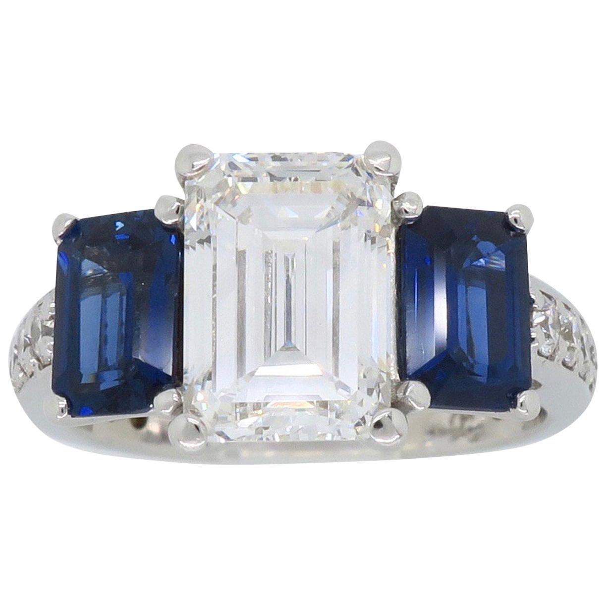 Emerald Cut Diamond and Blue Sapphire Three-Stone Engagement Ring