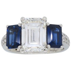 Emerald Cut Diamond and Blue Sapphire Three-Stone Engagement Ring