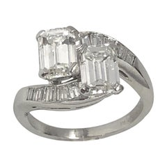 Emerald Cut Diamond and Platinum Bypass Ring