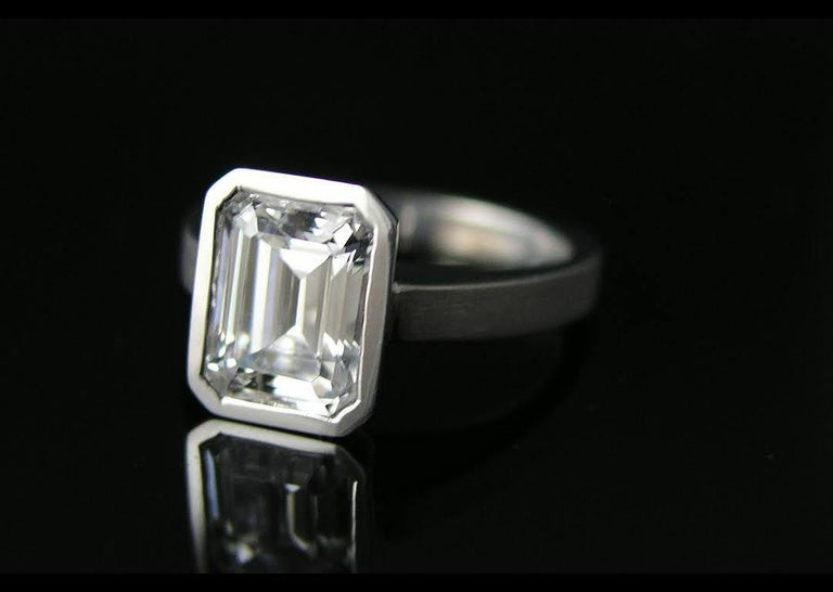 Contemporary Emerald Cut Diamond Bezel Solitaire Ring For Sale