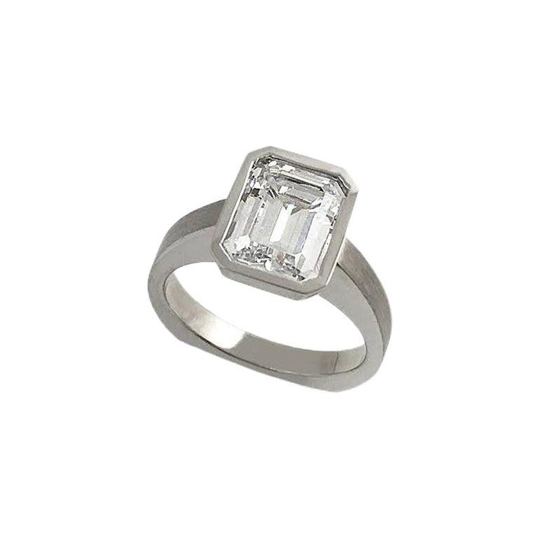 Emerald Cut Diamond Bezel Solitaire Ring For Sale
