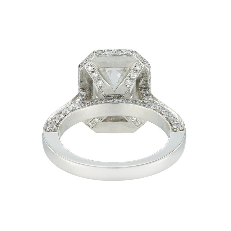 Modern Emerald-Cut Diamond Cluster Ring For Sale