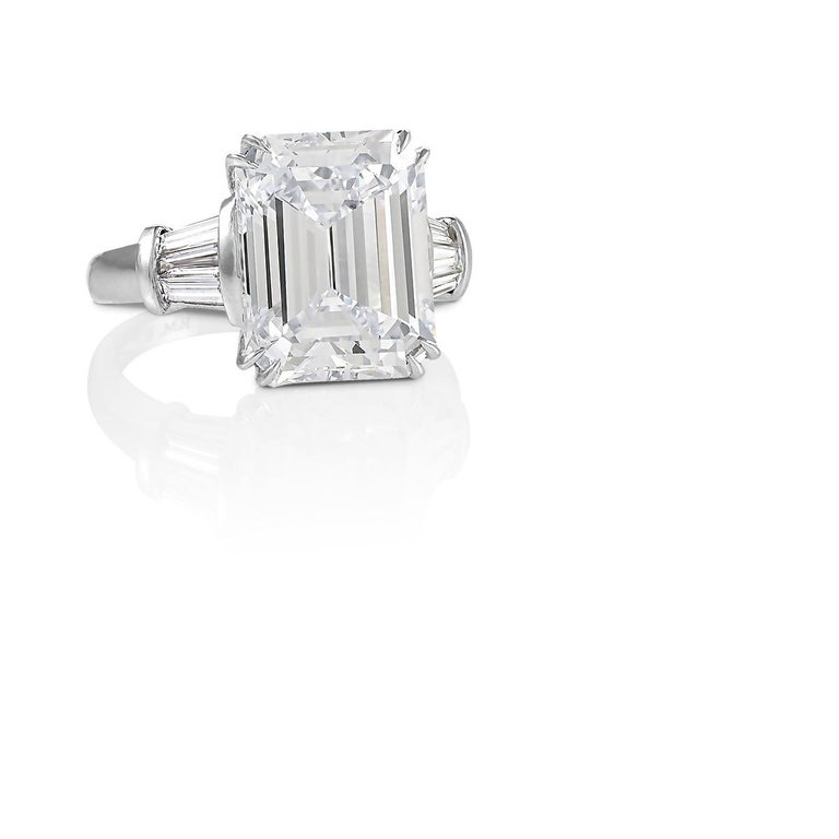A modern platinum ring with diamond by Roman Malakov. The ring has an emerald-cut diamond with an approximate total weight of 7.93 carats.   Ring size 6-3/4. Ring can be sized.  Signed, R.M. 950.