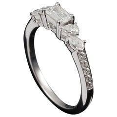 Emerald Cut Diamond Engagement Ring in 18 Karat Gold