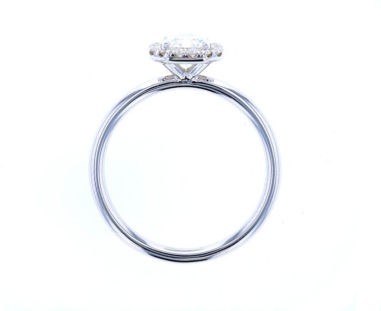Modern Emerald Cut Diamond Engagement Ring with Classic Diamond Halo For Sale