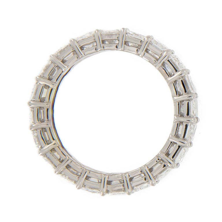 This diamond eternity ring showcases emerald-cut diamonds in a classic, common prong setting. Good things come to those who wait - time was taken to find diamonds that matched perfectly in D - E color, VVS clarity, excellent cut & weigh