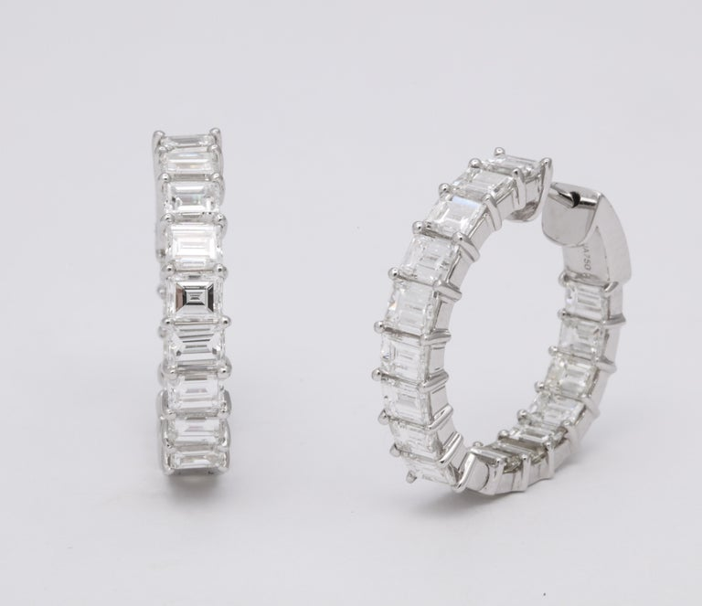 A UNIQUE pair of diamond hoop earrings!  7.93 carats of white Emerald Cut diamonds set in 18k white gold.   These hoops feature a secure push down lock  1 inch hoop size