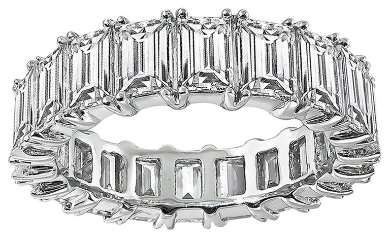 This gorgeous platinum eternity wedding band is set with sparkling emerald cut diamonds that weigh 6.20ct. graded H-I color with VS1 clarity. The band measures 5.5mm in width and weighs 7.1 grams. The band is size 6 1/2.   Inventory #60133NAKS