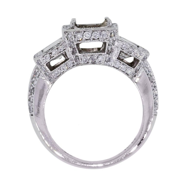 Material: Platinum Diamond Details: Approximately 2.50ctw emerald cut diamonds and round brilliant diamonds. Diamonds are G/H in color and VS in clarity. Mounting Details: 4 prong mounting, can accept emerald shape stone up to 7.24mm x 5.35mm Ring