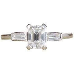 Emerald Cut Diamond Ring with Diamond Baguette Cut Shoulders in Platinum