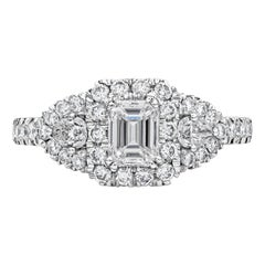 Emerald Cut Diamond Three-Stone Halo Engagement Ring