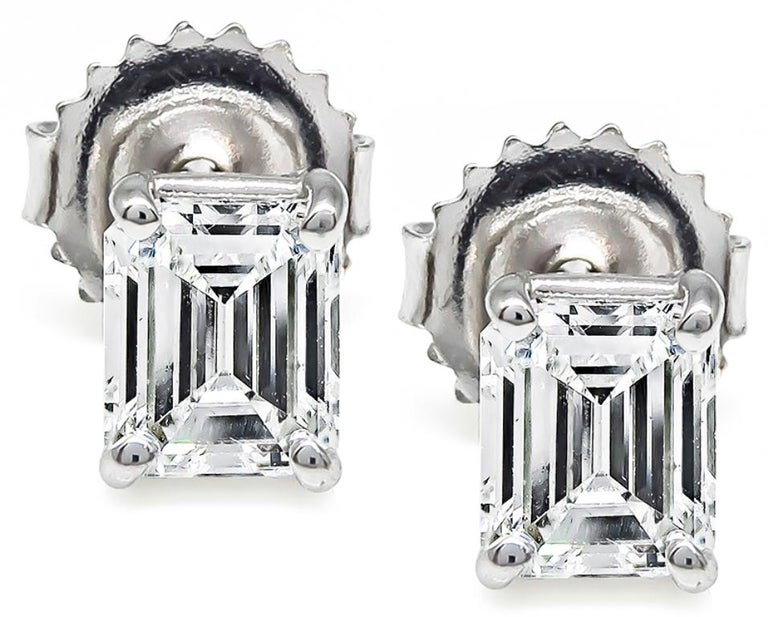 This is a stunning pair of 14k white gold stud earrings feature 2 sparkling emerald cut diamonds that weigh 1.32ct. graded G-H color with VS clarity. The earrings measure 6mm by 5mm and weigh 1.2 gram.     Inventory #16402PKBS