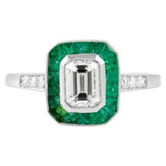 Emerald Cut Diamond with Emerald Around and Round Diamond Engagement Ring