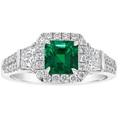 Emerald Cut Emerald and Diamond Three-Stone Halo Engagement Ring