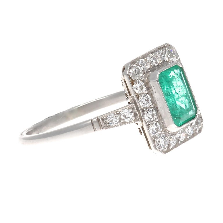 Inspired by the finest era of jewelry. Art Deco is a style of visual arts combining architecture and design that first originated in France before the commencement of the first world war. Featuring a 0.64 carat forest green emerald that is perfectly