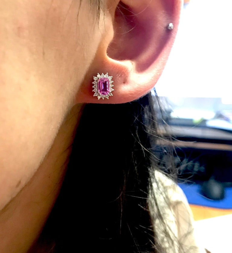 Material: 14k White Gold  Center Stone Details: 1.55 Carat Emerald Cut Pink Sapphire 4 x 6 mm Mounting Diamond Details: 32 Round White Diamonds Approximately 0.32 Carats - Clarity: SI / Color: H-I  Match this with our Emerald Cut Pink Sapphire &