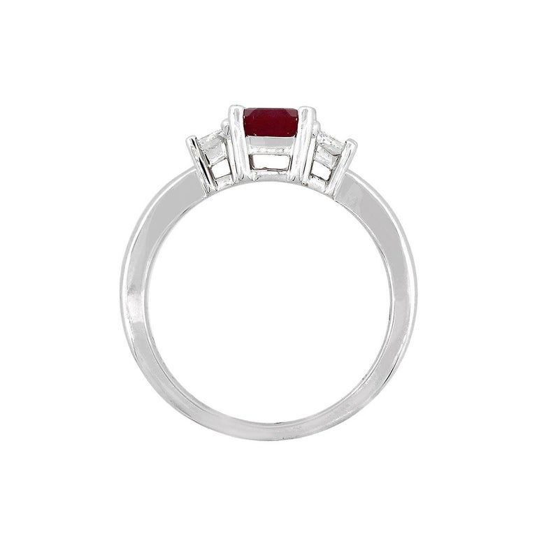 Emerald Cut Ruby and Trapezoid Diamond Three-Stone Ring In New Condition For Sale In Boca Raton, FL