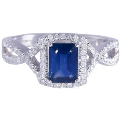 Emerald Cut Sapphire and Diamond Halo Style 14 Karat White Gold Ring