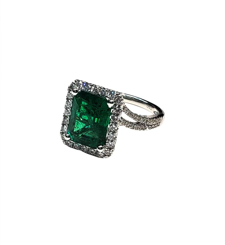 Emerald Cut Emerald (4.52ct)  White Diamond (.73ct)  White Gold (18k)