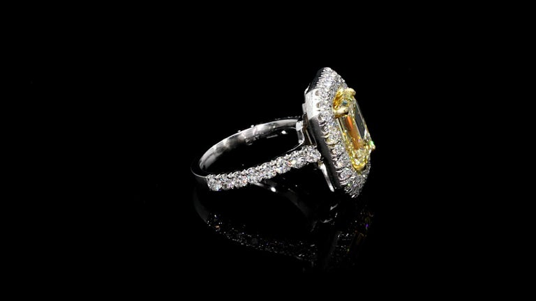 Emerald Cut Yellow Diamond Ring 6.12 carat Platinum/18KYG  Spectacular. Set in Platinum/18KYG  Stunning! Looks like nice FANCY YELLOW.  Emerald Cut weighs 4.01 carats  W-X  Color VVS1 Clarity GIA  Small Round Diamond weighs 2.11 carats  E/F Color VS