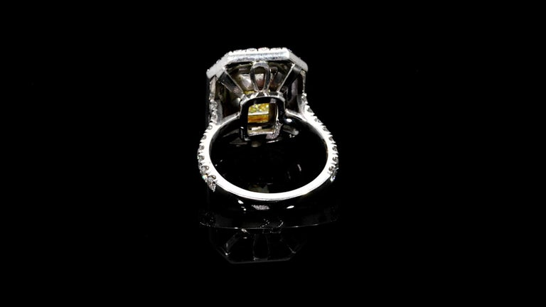 Contemporary Emerald Cut Yellow Diamond Ring 4.01 Carats Plat/18KY GIA Certified For Sale