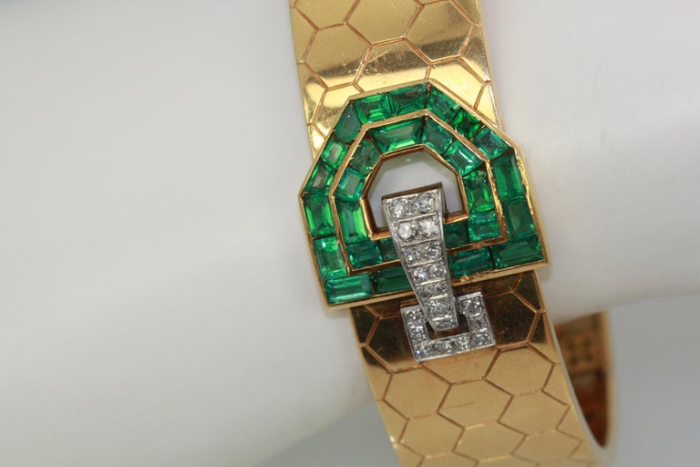 This Honeycomb Bracelet is set with Emeralds and Diamonds in a buckle style. This comes from Austria and boosts 30 Baguette Emeralds totalling approximately 4 carats and 20 Diamonds in a lovely bracelet. This fits a size 6 1/2 and the weight is