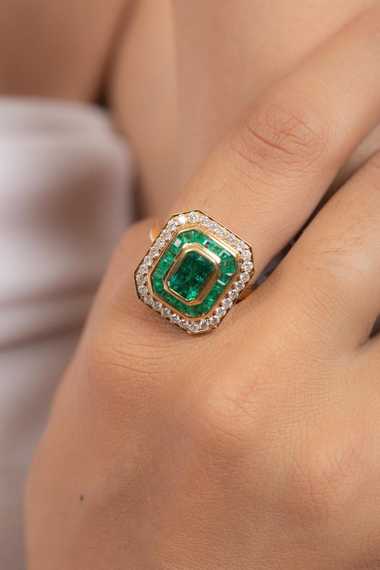 This ring has been meticulously crafted from 18-karat gold.  It is hand set with 3.03 carats emerald & .65 carats of sparkling diamonds.   The ring is a size 7 and may be resized to larger or smaller upon request.  FOLLOW  MEGHNA JEWELS storefront