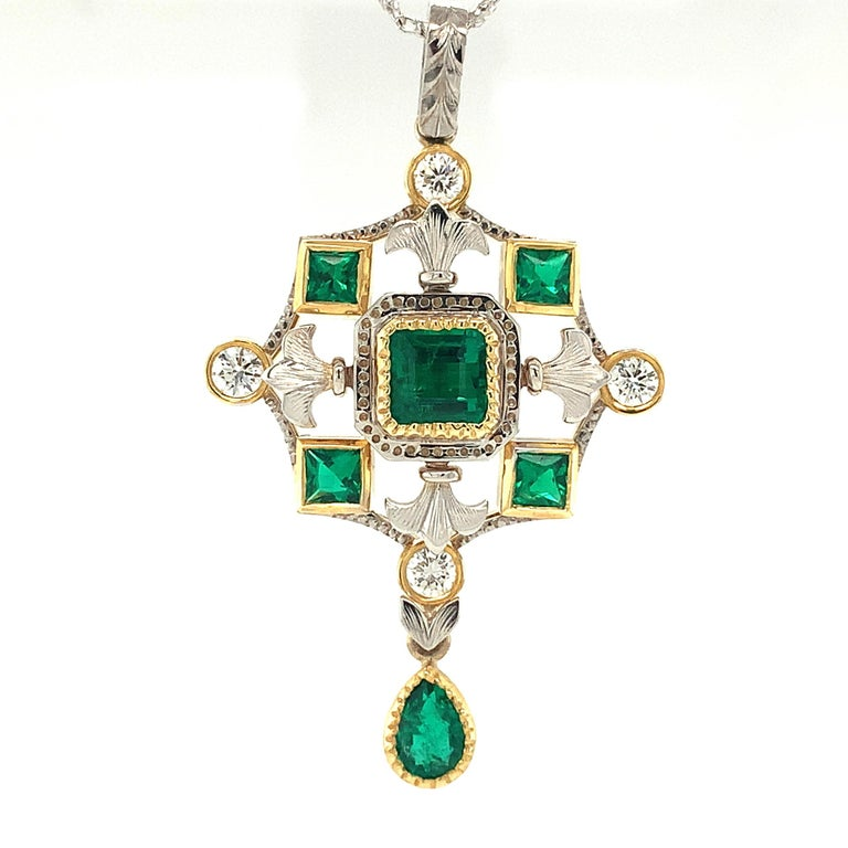 Rich, deep green emeralds in fancy square and pear shapes are set in this elegant pendant. It was handcrafted in 18k yellow and white gold with diamond accents by our Master Jewelers in Los Angeles. The level of craftsmanship and attention to detail