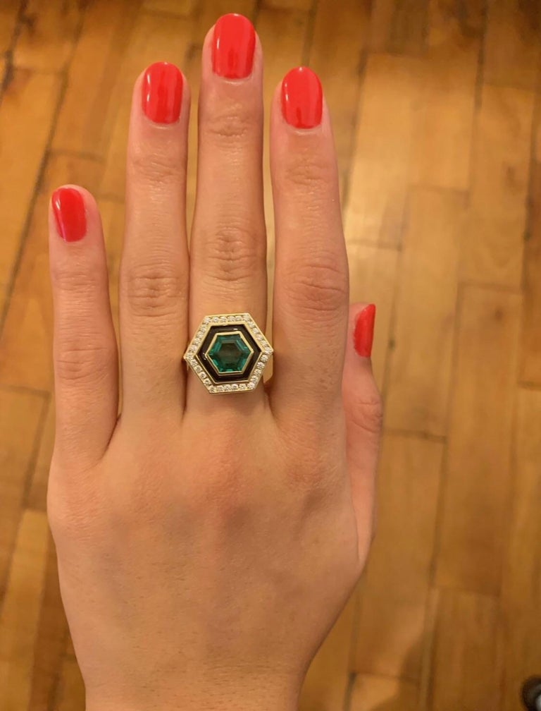 Beautiful 2.12 carat Hexagonally cut Emerald. A beautiful stone with a rich, strong emerald green color. It is surrounded by a black band of enamel and  .39 carats of GH color VSI diamonds. It is part of Andrew Glassford's Museum collection and is