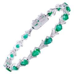 Emerald Diamond Bracelet in 18 Karat Gold Weighing 12.47 Grams in 0.69 Carat