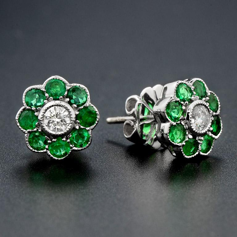 This Art Deco style of cluster earrings is simple and fashionable.  You could wear them for every occasion.  Earrings were made in 18K White Gold.   Diamond (G color SI1 clarity Round 3.0 mm.) 2 pcs. 0.21 carat at center. surrounded by Natural
